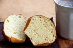 Sliced brioche on a napkin with hot cocoa Royalty Free Stock Images