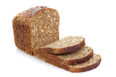 Sliced brown bread with cereals. Royalty Free Stock Photos