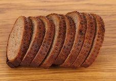 Sliced brown bread with coriander. Stock Photo