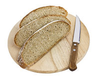 Sliced Brown Bread and Knife on Board Stock Photo