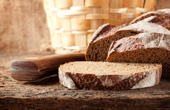 Sliced brown bread with knife Stock Image