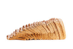 Sliced brown bread on wooden chopping board Stock Image