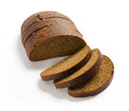 Sliced brown rye bread. With shadow on white background. Clipping path included Royalty Free Stock Image