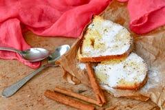 Bundt cake. Sliced Bundt cake and  cinnamon on wooden background Stock Photo