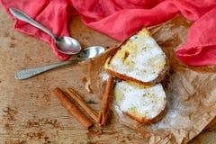 Bundt cake. Sliced Bundt cake and  cinnamon on wooden background Stock Photography