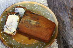 Sliced and buttered banana bread Stock Images