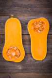 Sliced butternut squash on wood Royalty Free Stock Photos