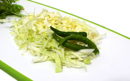 Sliced cabbage & green chillis Royalty Free Stock Photos