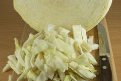 Sliced cabbage on a wooden cutting board Stock Photo