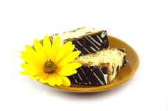 Sliced cake and the flower Stock Image