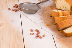 Sliced cake on wood table. Royalty Free Stock Photos