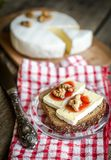 Sliced camembert on the bread Royalty Free Stock Photo