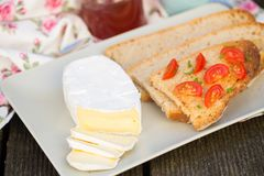 Sliced camembert cheese Stock Photography