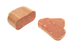 Sliced canned luncheon meat. A large piece of canned luncheon meat with two slices on a white background Royalty Free Stock Images