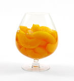 Sliced Canned Peaches. In a large glass goblet Stock Photo