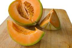 Sliced cantaloupe melon Stock Photos