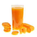 Sliced carrot pieces next to a juice bottle Royalty Free Stock Photos