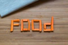 Sliced carrot on wooden background. Sliced word carrot on wooden background stock photo