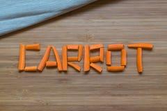 Sliced carrot on wooden background. Sliced word carrot on wooden background Stock Image