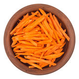 Sliced carrots in a brown plate. Isolated on white background. Stock Photography