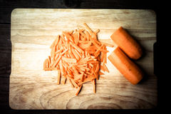 Sliced carrots on a wooden cutting board. Toned Royalty Free Stock Photos