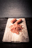 Sliced carrots on a wooden cutting board. Toned Stock Image