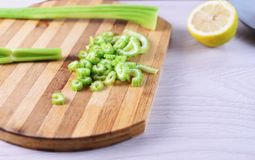 Sliced celery on cutting board Stock Images