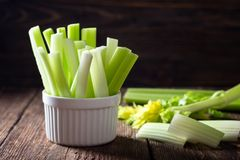 Sliced celery in a white bowl royalty free stock photo