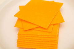 Sliced Cheddar Cheese on White Plate Royalty Free Stock Image