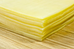 cheese slices. A close up of processed cheese slices on a wooden board Royalty Free Stock Image