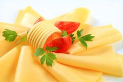 Sliced cheese, butter and tomato wedges Stock Image