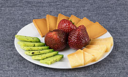 Sliced cheese on a plate. Royalty Free Stock Images