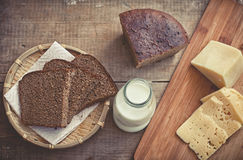 Sliced cheese, rye bread and milk Royalty Free Stock Photography