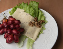 Sliced cheese salad and grapes walnut Royalty Free Stock Photography
