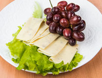 Sliced cheese salad and grapes walnut Stock Photo