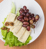 Sliced cheese salad and grapes walnut Royalty Free Stock Image