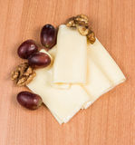 Sliced cheese salad and grapes walnut Royalty Free Stock Photos