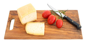 Sliced cheese on wooden board wth knife, isolated on white. Stock Photography
