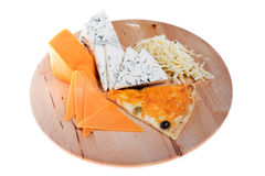 Sliced cheeses and pizza Stock Photography