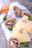 Sliced cheeses and walnuts Royalty Free Stock Photography