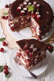 Sliced cherry cake with chocolate close-up. vertical top view Royalty Free Stock Image