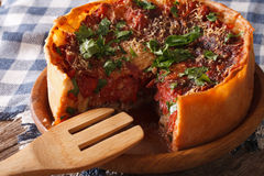 Sliced Chicago style deep dish pizza closeup on a plate. horizon Royalty Free Stock Image