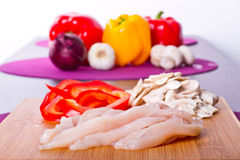 Sliced chicken breast for cooking. On cutting board Royalty Free Stock Photo