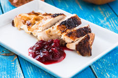 Sliced chicken breast with cranberry sauce Royalty Free Stock Photography
