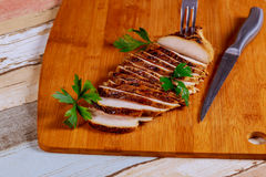 Sliced Chicken Breast fillet selective focus on wooden background Stock Photography