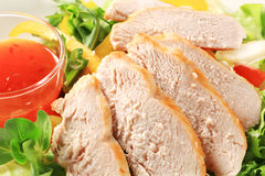 Sliced chicken breast with salad and chilli sauce Stock Photos