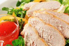 Sliced chicken breast with salad and sweet chilli sauce Royalty Free Stock Photography