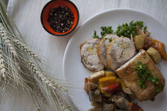 Sliced chicken breast and stiffed vegetables with parsley Royalty Free Stock Photo