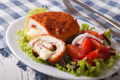 Sliced Chicken cordon bleu schnitzel and salad closeup. horizont Stock Images