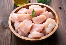 Sliced chicken meat. Chicken meat in wooden bowl, close up view Royalty Free Stock Images